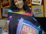 Cuddled up in the Peachtree Road Race Quilt